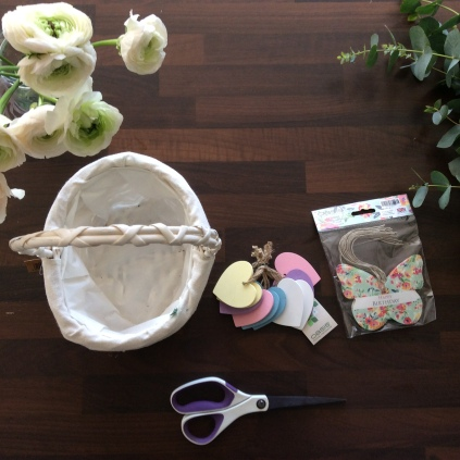 Aerial photo of basket, flowers and scissors