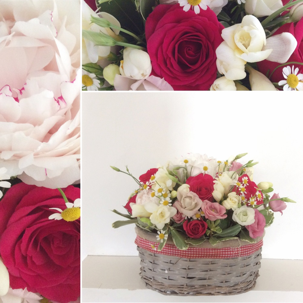 Basket arrangement with peonies and roses