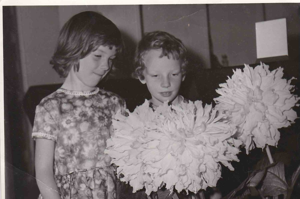 Two girls with dahlias